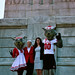 NC State Education Dean Mary Ann Danowitz and Ashley Lawson pose in front of the Belltower with Mr. & Ms. Wuf