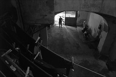 (By The Light of Common Day) (Robbie McIntosh) Tags: leicam9p leica m9p rangefinder streetphotography 35mm leicam autaut candid strangers leicaelmarit28mmf28iii elmarit28mmf28iii elmarit 28mm man woman blackandwhite monochrome bw rionesanità sanità totò wedding bride shadows napoli naples