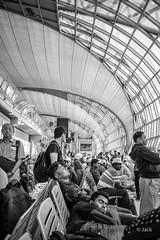 en passant par KL (Jack_from_Paris) Tags: r0003261bw ricoh gr apsc 28mm capture nx2 lr monochrom noiretblanc bw wide angle bangkok stop over airport aéroport transport thailande travel affiche bienvenue terminal boissons chariot personnes attente waisting time sieste nap cap architecture