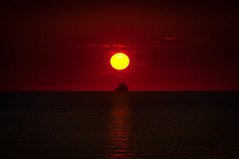 Voyage to the Sun (The Dutch Crow) Tags: sun sunset netherlands sea ship red yellow voyage autumn river horizon zeeland vlissingen sky clouds