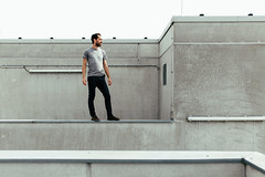 (kay fochtmann) Tags: achievement adventure alone altitude architecture building caucasian city concept confidence creative freedom future hero high leadership looking male man modern outdoor parkour person roof rooftop standing success think top urban view waiting walls winner