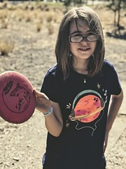 Evie Playing Disc Golf (pete4ducks) Tags: on1pics evie evangeline cropped iphone sunriver oregon travel 2018 vacation discgolf sharc summer kid child girl matte 500views