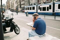AMSTERDAM, NETHERLANDS (aqawitt) Tags: iro200 iro irofilmneverdie amsterdam ams street snap streetphotography shootfilm film filmphotography fm2 gvb holland dutch man tram