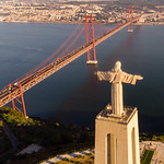 Aerial view of the Cristo Rei statue looking over the Tajo river onto Lissabon with Ponte 25 de Abril bridge thumbnail