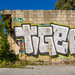 Street art, graffiti on the wall of abandoned ruin