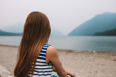 Serenity (Top KM) Tags: unwinding relaxing beach warm calm shoreline serenity summertime water travel outdoors summer mountain canada british columbia bc lake mountains silhouette woman one person girl female people day landscape explore foggy smoke