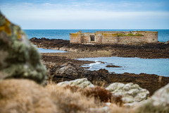 Fort Houmet Herbé (RichardJames1990) Tags: fort houmet herbé victorian castle granite quarry stone water breakwater old ruined ancient discovery turrets rocks grey pink blue sea ocean movement pebbles boulders beach concrete clear tranquil heather waves froth guernsey