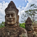Statues of Gods lining the causeway entering the ancient city of Angkor Thom near Siem Reap, Cambodia thumbnail