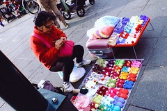 Street vendor selling her handcrafted knitted goods.. (tapsiman) Tags: people photograph dailylife urbanliving street