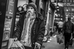 Onwards (Leanne Boulton) Tags: hat people urban street candid portrait portraiture streetphotography candidstreetphotography candidportrait streetportrait streetlife sociallandscape dutchangle old elderly man male face eyes expression mood feeling atmosphere beard scarf walking frame tone texture detail depthoffield bokeh naturallight outdoor light shade city scene human life living humanity society culture lifestyle canon canon5dmkiii 50mm primelens ef50mmf14usm black white blackwhite bw mono blackandwhite monochrome glasgow scotland uk