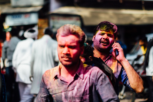 Man on Mobile Phone Covered in Gulal for Holi