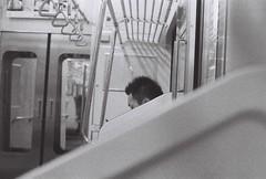 Training (Elios.k) Tags: film analoguephotography scannedfilm ilfordhp5plus blackandwhite monochrome analogfilm canona1 horizontal indoors people oneperson japanese train car interior traveller staringatsmartphone headonly dof depthoffield foregroundblur backgroundblur travel travelling vacation canon a1 camera photography december 2017 analoguecamera sendai yamagata miyagiprefecture yamagataprefecture senzailine tōhokuregion tohoku honsu asia japan