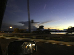 Looking Out at the Sunset IMG_4038 (soniaadammurray - On & Off) Tags: iphone driving sky clouds water sea boats road fence trees light car mirror reflections shadows artchallenge sunset quartasunset quote aspiration assurance beauty color conviction inspirational maturity