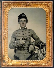 West Point Cadet George A. Custer (ca. 1860).  Quarter-plate ambrotype by an unidentified photographer. (lhboudreau) Tags: nationalportraitgallery smithsonian washington dc frame framed goldframe person man framedphoto portrait blackwhite blackandwhite monochrome quarterplate ambrotype 1860 cadet militarycadet westpoint westpointcadet georgecuster georgeacuster georgearmstrongcuster custer uniform militaryuniform portraitgallery pistol gun pocketpistol weapon cap kepi usmilitaryacademy pose posed seated soldier military
