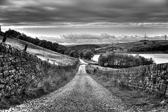 Keep off the moors .. stick to the road! (Missy Jussy) Tags: road moors keepoffthemoorssticktotheroads keepoff piethornevalley piethorne valley mono monochrome moodylandscape blackwhite bw blackandwhite 50mm ef50mmf18ll ef50mm canon50mm fantastic50mm canon5dmarkll canon5d canoneos5dmarkii canon path drystonewalls reservoir trees clouds sky pylons landscape lancashire northwest england pennines