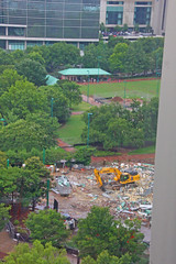 Construction Outside our Hotel Room Window, Downtown Atlanta, GA (gg1electrice60) Tags: hiltongardeninn hotel viewfromhotelwindow viewfrommyhotelroom photographedfrom13thfloor photographedfromthirteenthfloorwindow backhoe dumptruck centennialolympicpark downtown downtownatlanta 275bakerstreet 275bakerst fultoncounty atlanta georgia unitedstates usa us america constructionequipment constructionsite park trees shrubs dirt debris demolitiondebris constructiondebris
