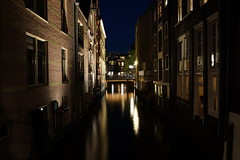 Narrow Canal (steve_whitmarsh) Tags: amsterdam netherlands holland city urban building architecture night lights canal water reflection topic