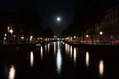 Moonlight in Amsterdam (steve_whitmarsh) Tags: amsterdam netherlands holland city urban building architecture night lights canal water reflection moon topic