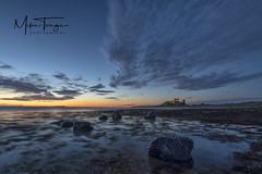 "Bamburgh ""Blue"". (miketonge) Tags: bamburghcastle bamburgh beach sky sunrise dawn bluehour rocks castle islands farneislands lighthouse seascape sea seaweed tide"