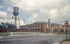 Factory Tank on 828 Film (Neal3K) Tags: 828film georgia griffinga rr railroad fppc41kit watertank watertower stopsign rrsignal