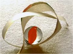 Not your usual Knot ! (jesse1dog) Tags: newspaper strip marble tabletop orange knot smileonsaturday lifeisarainbow gm1 olympuszuikoomautomacro50mm 50mm twist edge circle knotsobad