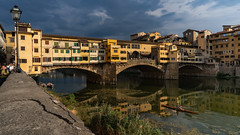 Ponte Vecchio Lifestyle (Sworldguy) Tags: a73 camera country florence italy sonya73 pontevecchio bridge firenze cloudy historical arnoriver rower boat italia romantic reflections architecture europe tuscany goldenhour sunset water light cityscape calm cityliving landscape building sky