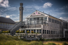 The Lobster Pot Restaurant with the Pilgrim Tower in the background. (donnieking1811) Tags: massachusetts provincetown lobsterpotrestaurant restaurant deck exterior outdoors pilgrimtower tower sky clouds blue windows stairs hdr canon 60d lightroom photomatixpro