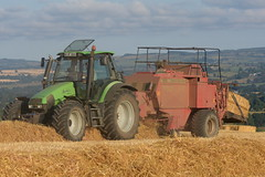Deutz Fahr Agrotron 135 Mk3 Tractor with a Massey Ferguson 185 Series 2 Cut Chamber Baler (Shane Casey CK25) Tags: deutz fahr agrotron 135 mk3 tractor massey ferguson 185 series cut chamber baler deutzfahr sdf df grain harvest grain2018 grain18 harvest2018 harvest18 corn2018 corn crop tillage crops cereal cereals golden straw dust chaff county cork ireland irish farm farmer farming agri agriculture contractor field ground soil earth work working horse power horsepower hp pull pulling cutting knife blade blades machine machinery collect collecting nikon d7200 traktor traktori tracteur trekker trator ciągnik castlelyons