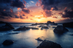 Rocks and clear water (bjorns_photography) Tags: landscape nature sunset ocean water rock seascape sea rocks photography clouds clody