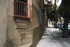 Wrought iron (ADMurr) Tags: la apt wrought iron window sidewalk street stucco texture leica m6 40mm summicron kodak 200 daa977