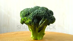 Broccoli, shooting in the movement. (daria.boteva) Tags: broccoli background vegetable vegan food fresh organic salad agriculture closeup cooking cuisine diet dietetic dieting eating freshness gourmet green health healthy kitchen nature nutrition raw rural vegetarian vitamin water brocoli cabbage motion veg greenstuff meals wholesome cutting board wooden home market
