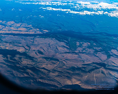Windmills on Foothills Back to the Rocky Mountains From 24,000 Feet ASL (AvgeekJoe) Tags: aerialphotograph d5300 dslr mountains nikon nikond5300 rockymountains tamron18400mm tamron18400mmf3563diiivchld aerial aerialphoto aerialphotography windmill windmills