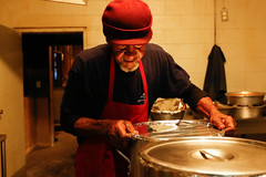 Bob Hall, an employee at Holcomb's Barbecue, seals the brunswick stew in containers. The employees cook everything at one location in White Plains, and then transport it to the other location in downtown Greensboro.