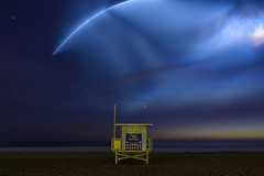 ave 26 / space-x. venice beach, ca. 2018. (eyetwist) Tags: eyetwistkevinballuff eyetwist ave26 lifeguard rocket spacex falcon9 satellite launch longexposure night pacificocean venice beach venicebeach losangeles la oceanfrontwalk pacific baywatch 26thavenue westla angeleno socal california nikon d7000 18200mmf3556gvrii 18200mm nikkor sand water ofw los angeles alienskinexposure exposure alienskin processed photoshop postprocessed postprocessing filter nik colorefex wide tower hut stand horizon explosion bomb seascape vandenbergafb space x dusk stars streak curve orbit ocean