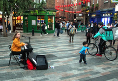 Dancing in the Street (iwys) Tags: child dancing street musician busker london small boy young woman bicycle chinatown