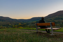 Lovely View (alexander_skaletz) Tags: bench person portait tree sun sunny landscapes landscape landscapephotography nature photography warm grass sunset green fall yellow october trees village germany badenwürtemberg nikon mountains south blue naturelovers autumn