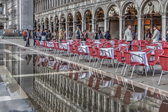 Acqua alta (Marion McM) Tags: water hightide flood stmarkssquare venice tourists columns arches tables chairs streetphotography street italy canoneosm6 tonemapped sea seawater tide