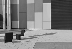 ... chairs and shadows ... (christikren) Tags: austria architecture christikren emptyseats lines monochrome panasonic wien vienna abstract chairs shadow grey wall geometry