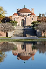 The exterior of the historic 1908 Lakewood Memorial Chapel in Minneapolis, Minnesota,  The chapel was designed by architect Harry Wild Jones. The design was based on the Hagia Sophia in Instanbul, Turkey (thstrand) Tags: reflection reflections reflectingpool water gardens garden landscapearchitecture 19001909 1908 1909 american architecturalstyle architecture backgrounds beigegranite building buildings builtstructure byzantinerevival chapels charleslamb christian christiansymbols church dome early20thcentury exterior front harrywildjones historicsite history lakewoodcemetery mn memorialchapel minneapolis minnesota nationalregisterofhistoricplaces nobody outside religion religious roof sanctuary stcloudgranite stone structures traveldestination us usa unitedstatesofamerica