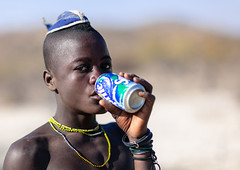 Himba tribe young man drinking a Sprite, Cunene Province, Oncocua, Angola (Eric Lafforgue) Tags: adult africa africantribe angola angolan colourimage copyspace cultures cuneneprovince day developingcountries drinking hair hairstyle headwear herero himba horizontal humanbeing indigenousculture lifestyles lookingatcamera oncocua onemanonly oneperson outdoors photography portrait ruralscene single soda sprite tribal tribe waistup youngman ang0k6g7195