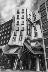 Frank Gehry Building – MIT (allentimothy1947) Tags: boston cambridge gehry ma mit massachusetts architecture building design sky street black white academic bw clouds people photography windows