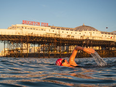 Murielle in the morning sun (lomokev) Tags: file:name=181024omdem5240680 brighton swim swimming swimmers sport olympusomdem5 olympus omd em5 olympusomd pier brightonpier palacepier morning sunrise murielle frontcrawl brightonswimmingclub wildswimming openwaterswimming