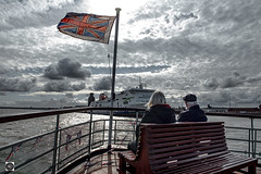 Take a Bow, when the Sun`s too Stern. (alundisleyimages@gmail.com) Tags: rivermersey merseyferry ferryacrossthemersey passengers people ship shipping maritime clouds sky flag unionjack weather ports harbours bench rails birkenhead wirral