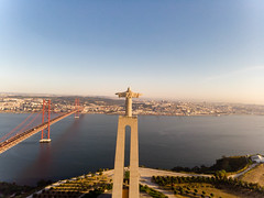 Aerial view from behind of the Cristo rei monument with ponte 25 de abril bridge in Almada Lisbon (verchmarco) Tags: locationindependent dnx lisbon aerialaesthetics luftbildaufnahme aerial portugal dji lisboa reiseblogger luftaufnahme digitalnomad reisen travel lissabon mavicair aerialphotography noperson keineperson water wasser reise bridge brücke city stadt architecture diearchitektur sky himmel sunset sonnenuntergang outdoors drausen landscape landschaft sea meer river fluss dawn dämmerung daylight tageslicht cityscape stadtbild skyline horizont transportationsystem transportsystem seashore strand light licht vehicle fahrzeug path harbour brown morning perfectmatch national hiking woods sunny fog