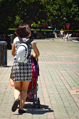 Cute airplane backpack (NettyA) Tags: asia china huangpudistrict peoplespark shanghai aeroplanebackpack city mother park pushingpram streetscene travel trees walking