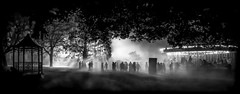Never Ending Night by Simon Hadleigh-Sparks (Simon Hadleigh-Sparks) Tags: night dark fog mist people simonandhiscamera silhouette trees carousel park bw blackandwhite contrast composition evening enchanted fair gardens monochrome outdoor syonpark vignette syonhousepark