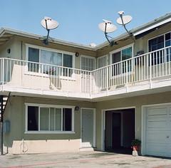 Redwood City (bior) Tags: hasselblad500cm carlzeiss portra160nc kodakportra expiredfilm mediumformat 120 6x6cm suburbs redwoodcity wall stairs balcony apartments dish