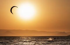 7622  Capturing The Sun (foxxyg2) Tags: aegean kites surfing sun sunset gold kastraki naxos cyclades greece greekislands islandlife islandhopping kitesurfing