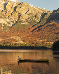 Pyramid Lake Canoe (Terry L Richmond) Tags: lake water mountain river reflection nature landscape boat sky tree outdoor wilderness leaf background floating wood fall loch canoe body sitting travel bank small noperson nationalpark pond scenic reservoir large outdoors morning bench dawn autumn sunset rock escarpment composure lakedistrict fjord hill fell pyramidlake jasper canadianrockies alberta tourism jaspernationalpark