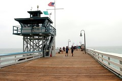 San Clemente Pier (Prayitno / Thank you for (12 millions +) view) Tags: sanclemente saint st clement pier dermaga beach from pacific ocean shore line us flag life guard tower walk pedestrian leisure activity outdoor fun day cloudy haze hazy fog sea coast coastal